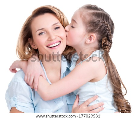 young daughter  kissing mother - isolated. Happy family people concept. - stock photo