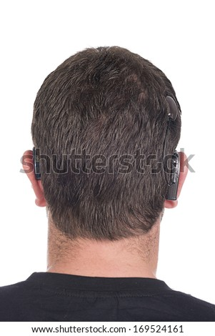 young deaf or hearing impaired man with cochlear implant and hearing aid photographed from behind to show device