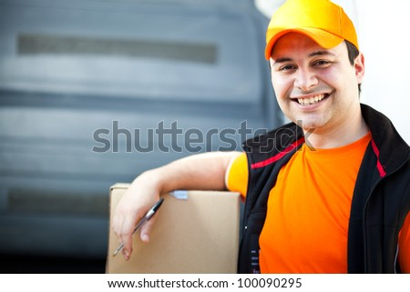 Young delivery boy portrait - stock photo