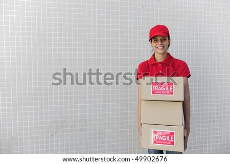 young delivery courier delivering package. copy space - stock photo