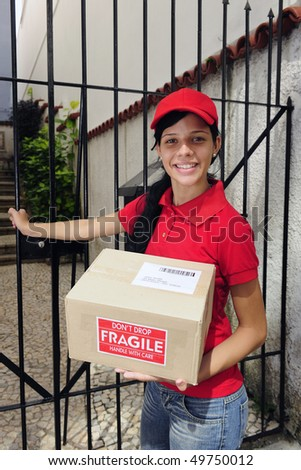 young delivery courier delivering package outdoors