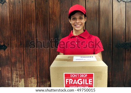 young delivery courier delivering package with copy space - stock photo