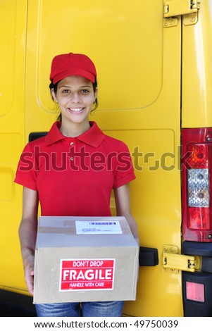 young delivery courier or mailman delivering postal packages - stock photo