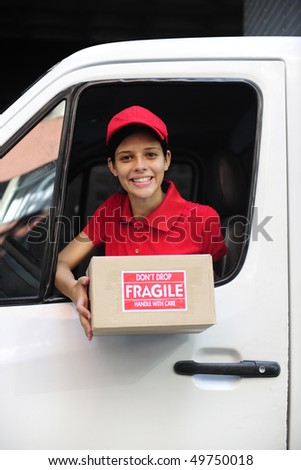young delivery delivery courier in truck handing over package