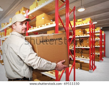 young delivery man at work in a classic warehouse