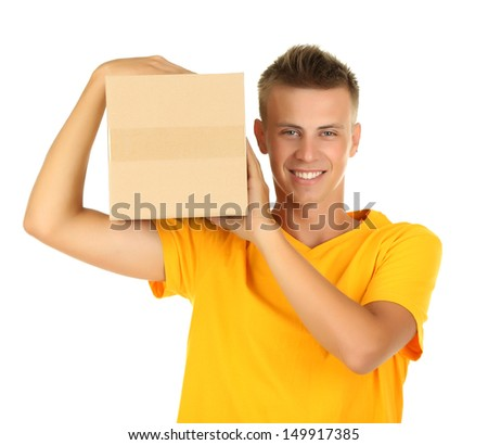 Young delivery man holding parcel, isolated on white - stock photo