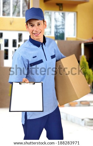 Young delivery man, in front of a house.