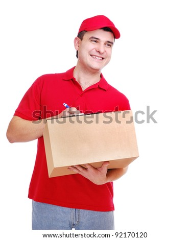 Young delivery man in red uniform filling the form on the box on white background - stock photo