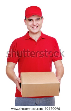 Young delivery man in red uniform holding the box on white background