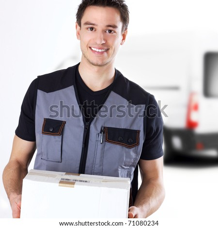young delivery man with box - stock photo