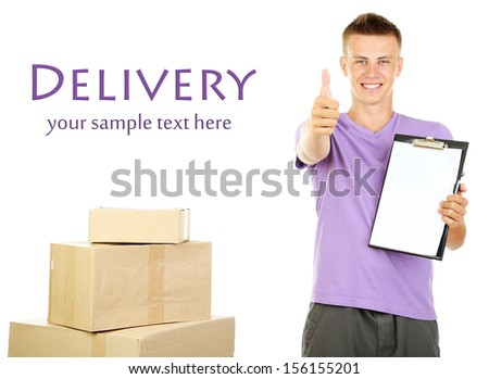 Young delivery man with parcels and clipboard, isolated on white - stock photo