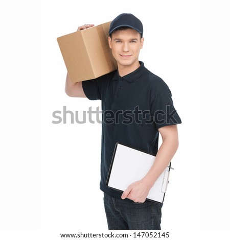 Young deliveryman at work.  Cheerful young deliveryman holding carton box and clipboard while isolated on white - stock photo