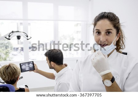 Young dentist posing in dental clinic