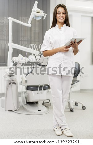 Young dentist with tablet