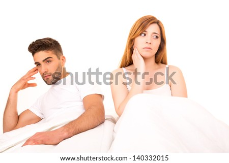Young depressed couple in bed - daylife problems concept - stock photo