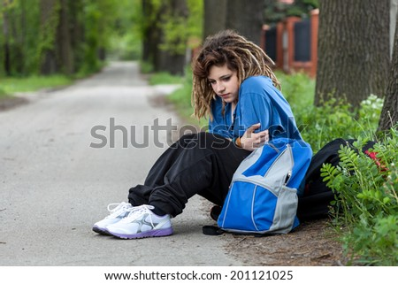 Young depressed rude girl probably has a addiction problem - stock photo