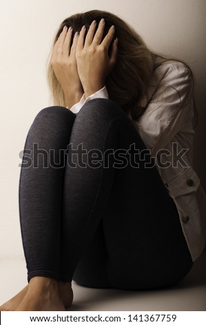 Young depressed woman - stock photo