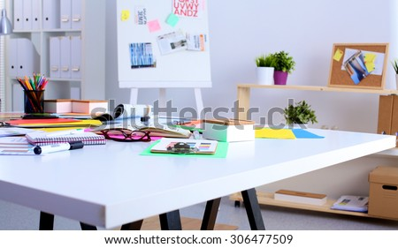 young designer working at his desk with a computer - stock photo