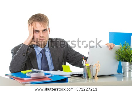 young desperate businessman overworked and upset looking worried and angry sitting at computer desk on white background office in business project stress problem - stock photo