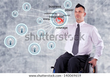 Young disabled Business man with his wheelchair, hand choosing one of the options on touch screen technology - stock photo