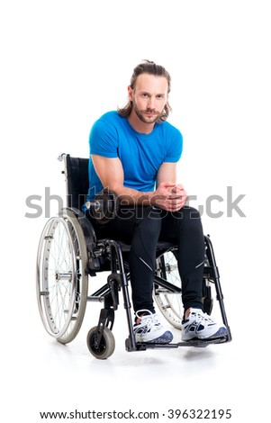 young disabled man in wheelchair train with bar-bell - stock photo