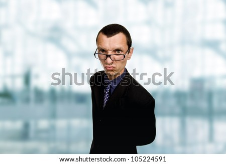 young distorted business man at the office - stock photo