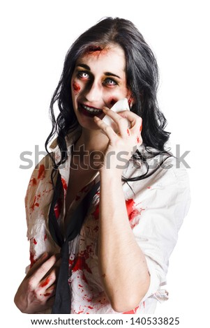 Young distressed zombie businesswoman with visible wounds and staring eyes  wiping her face with a cloth isolated on white background - stock photo
