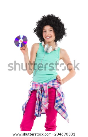 Young DJ teen girl. Teen girl in afro wig holding compact disc. Three quarter length studio shot isolated on white. - stock photo