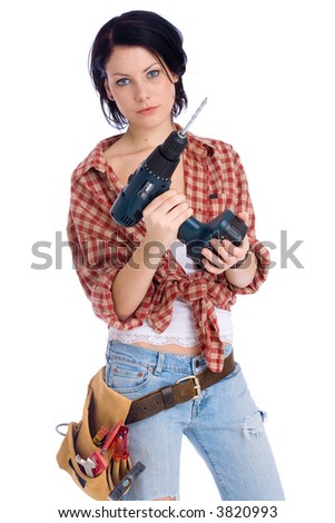 young do-it-yourselfer with a drilling machine - stock photo