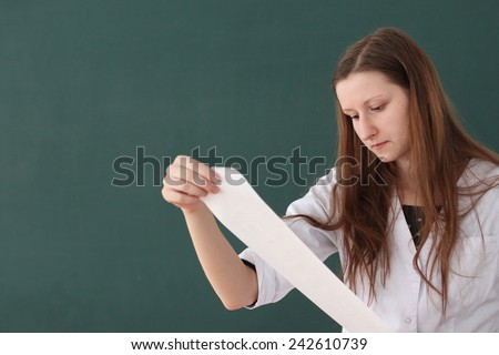 Young doctor analyzing test results