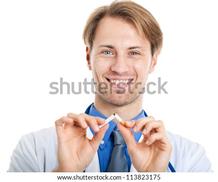 Young doctor breaking a cigarette - stock photo
