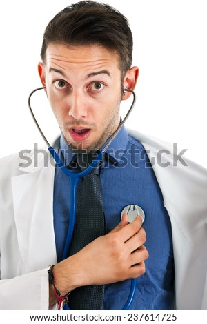 Young doctor checking himself with a funny expression - stock photo