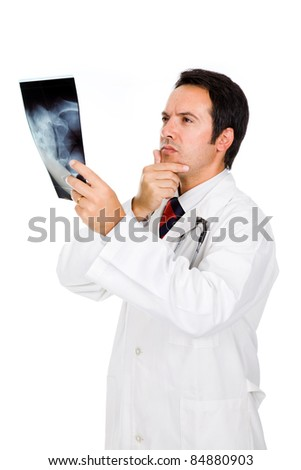 Young doctor examining an x-ray, isolated on white - stock photo