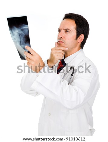 Young doctor examining an x-ray on white background