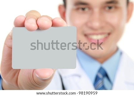 Young doctor holding business blank card. Isolated on white background