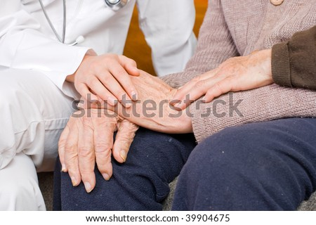 Young doctor holding the lady's hand
