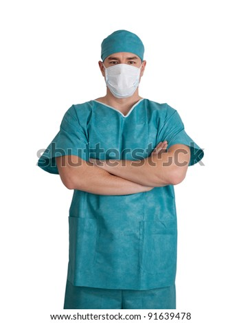 Young doctor in scrubs with hands folded. Isolated on white background. - stock photo