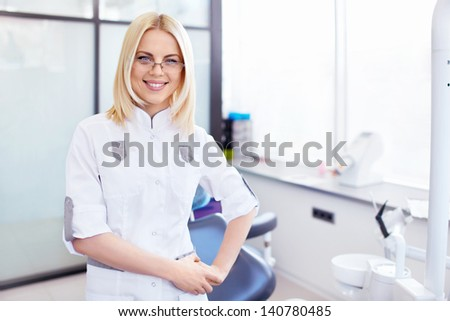 Young doctor in the cabinet - stock photo