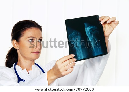 Young doctor in their medical practice with an X-ray