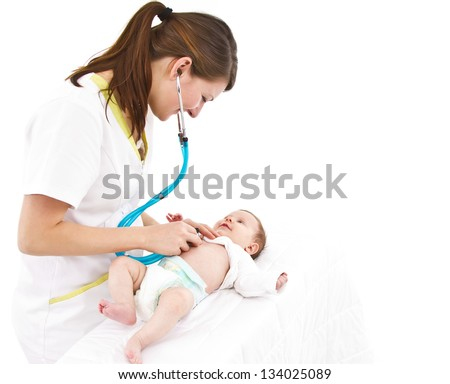 young doctor is examining a little baby with a stethoscope - stock photo