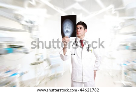 Young Doctor looking at an x-ray - stock photo