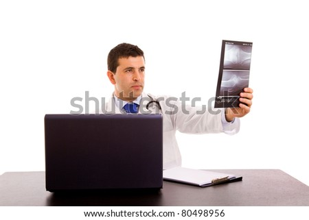 Young Doctor looking at an x-ray, isolated on white - stock photo