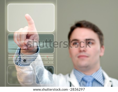 Young doctor pushing a glowing area on a translucent, futuristic medical display.