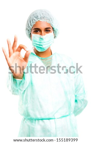 Young doctor signaling ok, isolated over a white background