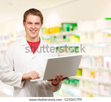 Young Doctor Using Laptop, Indoors