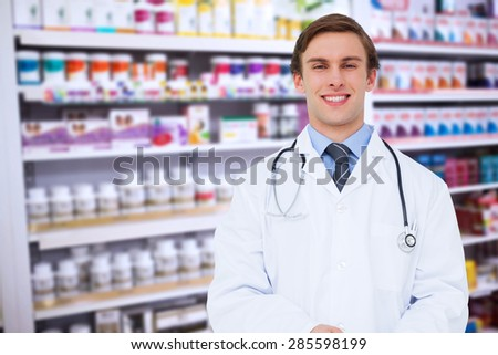 Young doctor using tablet pc against close up of shelves of drugs