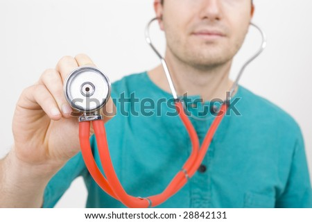 Young doctor with a stethoscope in his hand