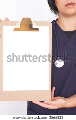 young doctor with empty presentation board for your messages - stock photo