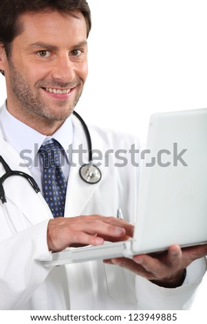 Young doctor with laptop - stock photo