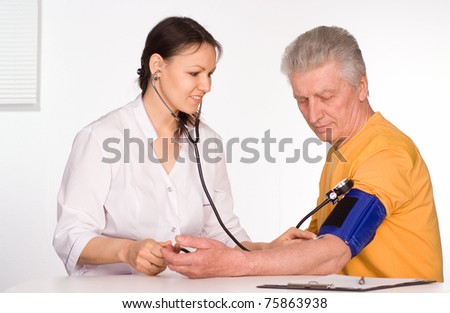 young doctor with patient on white background - stock photo